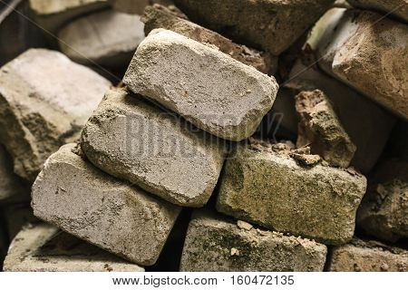 bricks from the destroyed house earthquake. destroyed building