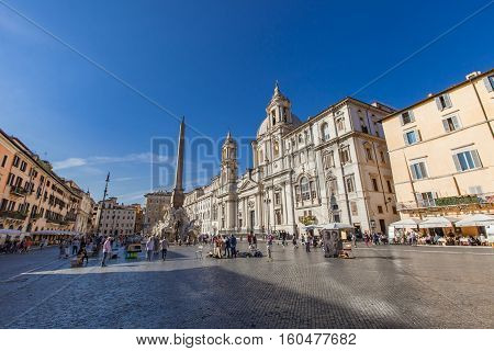 ROME, ITALY - SEPTEMBER 24, 2016: Unidentified people on the Piazza Navona in Rome Italy. Piazza Navona is a popular destination in Rome the 3rd most visited city in European Union.