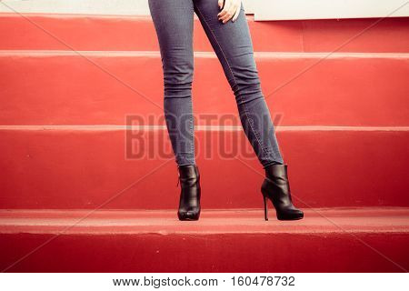 Woman Legs In Denim Pants High Heels Shoes Outdoor