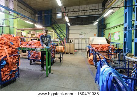 NIZHNY NOVGOROD, RUSSIA - NOVEMBER 28, 2016: Sewing workshop for production of nylon down cargo straps. Department of packing of finished products.