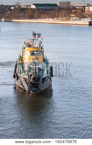 MOSCOW, RUSSIA - NOVEMBER 11, 2016: State Unitary Enterprise Mosvodostok performs recovery vessels on coastal winter parking. Ship of Mosvodostok on the Moscow River.