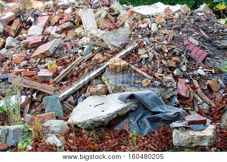 A heap of construction and demolition debris garbage bricks and material of an old house.