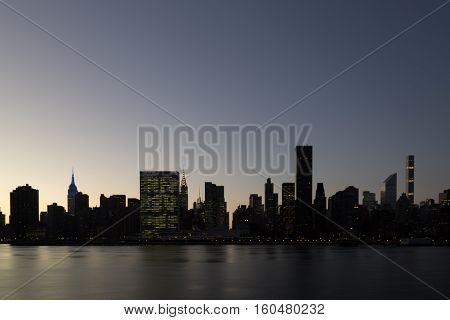 Silhouette of the skyline of midtown Manhattan in New York during sunset time