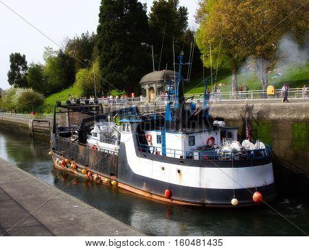 An industrial boat docked at the Ballard Locks in Seattle, Washington (US)