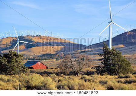 Giant Wind Turbines producing clean green alternative energy to urban areas taken in Tehachapi Pass, CA
