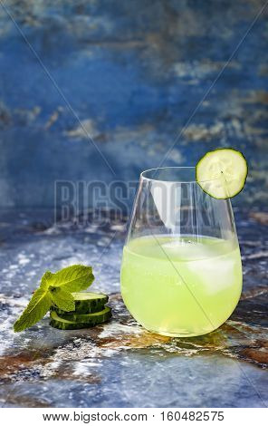 Sparkling cucumber mint gin and tonic fizz with aloe vera on marble table