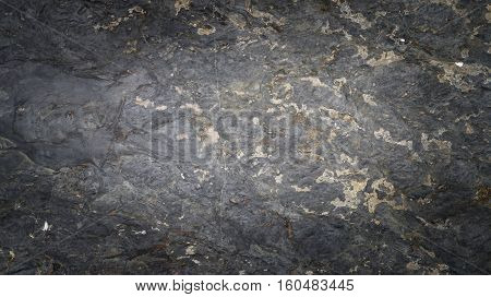 Black texture of the rock, Detailed structure of rock, Abstract natural black rock dark border for design.