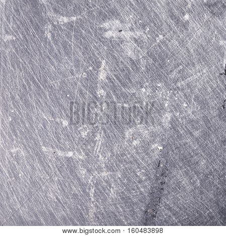 Scuffed iron sheet textured background. Grey color