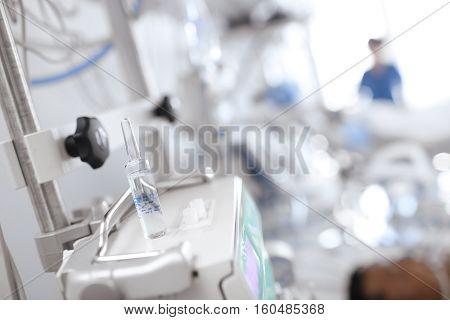 Drug ampule on the modern equipment in ICU.