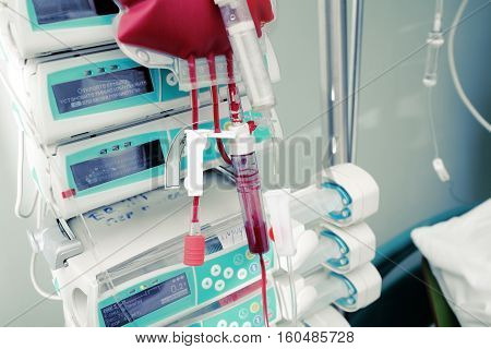 Blood bag on the background of hospital equipment.