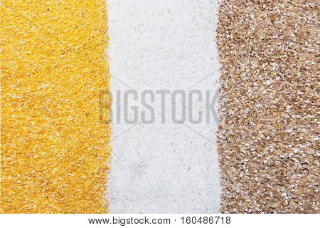 corn semolina and wheat groats background texture
