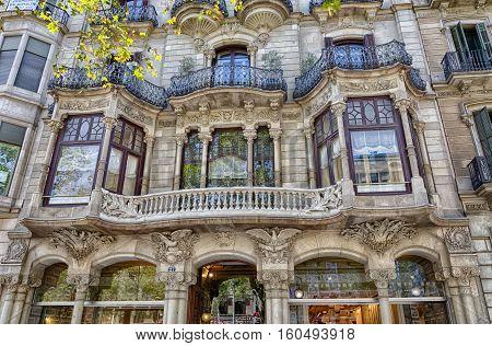 Splendid facade of building in Barcelona city center, summer Spain