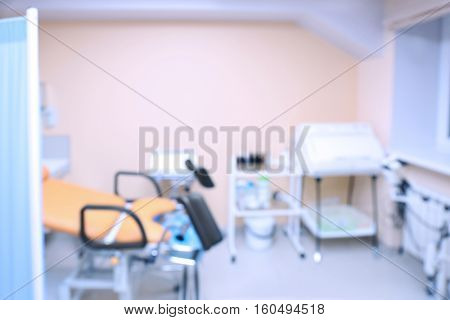 Gynecological room with chair, blurred background
