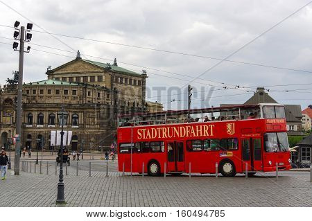 DRESDEN GERMANY - JULY 13 2015: Classic city sightseeing bus MAN SD200 at the city street of Dresden.