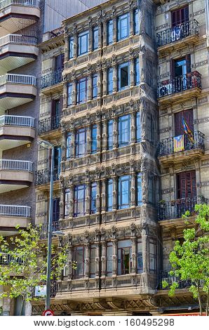 Interesting cubic balconies in city center of Barcelona, summer Spain