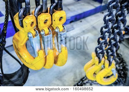 New chain cargo sling. Black steel chain and yellow cargo hooks.