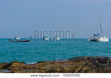 Beautiful landscape seaview with catamaran and a boat at beach of Laem Panwa Cape famous attractions in Phuket island Thailand