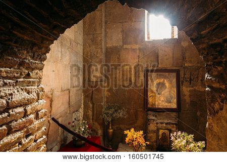 Mtskheta, Georgia - May 20, 2016: The View Through Arch To The Icon Of Theotokos Under Window In The Stone Interior Of Jvari Church, Ancient Georgian Orthodox Monastery, Famous Landmark.