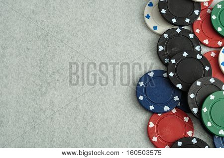 Poker chips forming a border with a white background