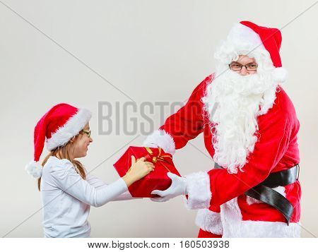 Santa Claus Fighting With Girl For Present