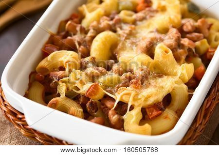 Chili con carne and macaroni pasta casserole in baking dish photographed with natural light (Selective Focus Focus in the middle of the image)