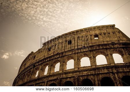 View of Colosseum in front of sun Italy Europe.