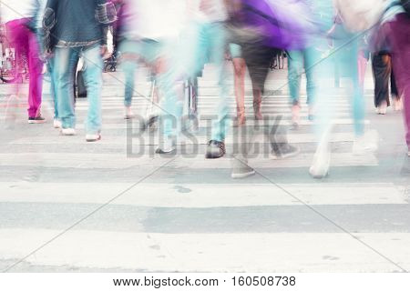 filtered blur abstract people background unrecognizable people walking on a street