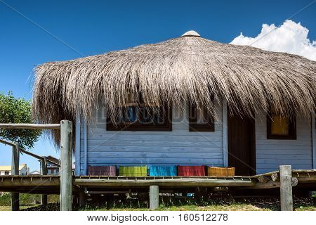 Typical brightly colored hous on the picturesque beach in Punta del Diablo popular tourist place in Uruguay