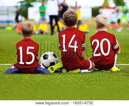Football Game for Kids. Young Boys Soccer Players Athletes. Children Football Players at Match with Ball. Soccer Bench of Youth Team. Footballers in Red Sportswear