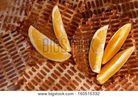Background of crunchy wafers home and orange slices