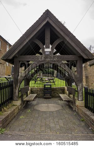 Wooden memorial shelter formerly housing the village pump. Erected to commemorate Queen Victoria's diamond jubilee in the village of Bearsted Kent UK