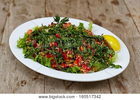 Oriental, anatolian salad with chopped tomatoes persley and groats.