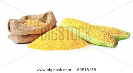 Bag with corn seeds, cornmeal and corncobs isolated on white