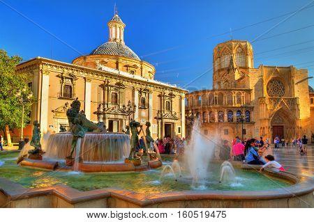 Valencia, Spain - October 29, 2016: Square of Saint Mary and fountain Rio Turia in Valencia