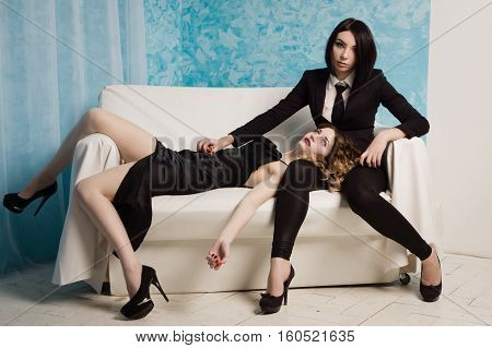 Hitwoman On The Couch Next To The Corpse Of A Beautiful Woman