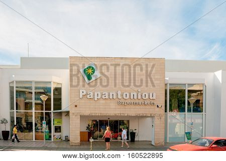 PAPHOS CYPRUS - OCT 28 2014: Papatoniu supermarket chain in Cyprus on a sunny day with people entering to buy food and non-food products. Papatoniu is the leading supermarket in Cyprus