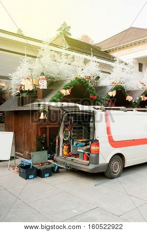 White van with diverse tools in the back preparing to arrange the Christmas stall at the Baden-Baden Christmas market