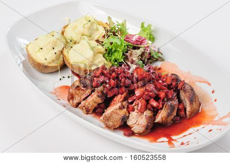 roasted beef slices with berry, apple and pear sauce, potatoes and green salad