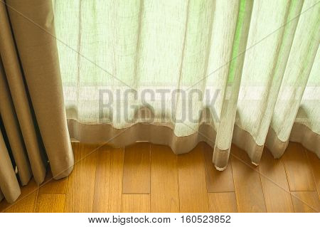 Curtain transparent window in the room with the light shining through the curtains background.