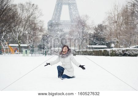 Cheerful Young Girl Enjoying Winter Day In Paris