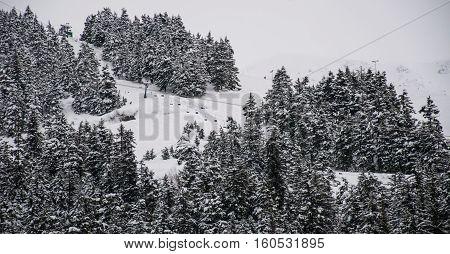Ski Lift riding up the side of a Alaska Snow Covered Mountain. Girdwood , Alaska , USA at Alyeska Ski Resort on a Powder Snow Winter Wonderland ski day