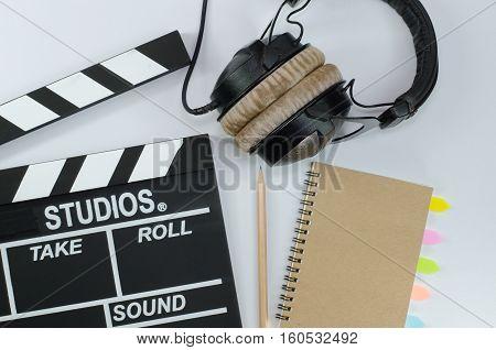 Slate film and notebook headphone white backgroun