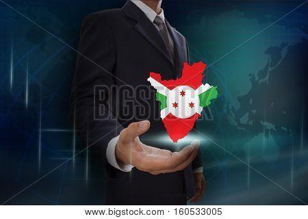 Businessman showing map of Burundi on globe background