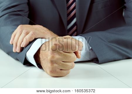 Close-up of a male fist. Tyranny in office