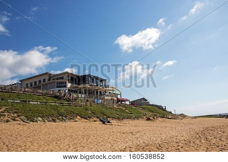 Empty Beach Against Commercial And Residential Buildings