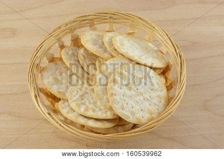 Table water crackers in wooden basket on wooden table