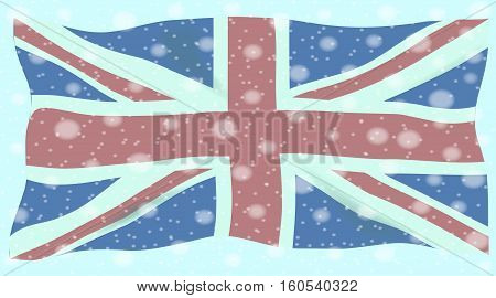 The British Union Flag or Union Jack with winter snow