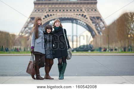 Three Girls Posing Near The Eiffel Tower