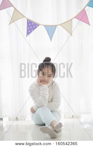 Portrait of Asian girl decorated the room with pastel bunting
