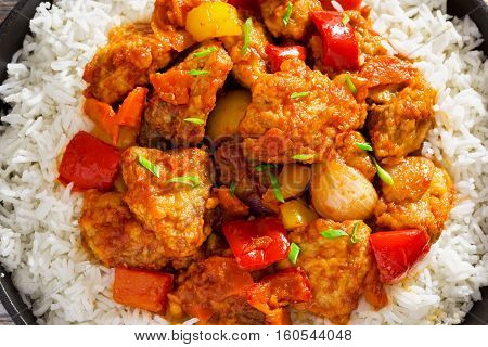 Sweet And Sour Crispy Fried Pork Pieces With Rice
